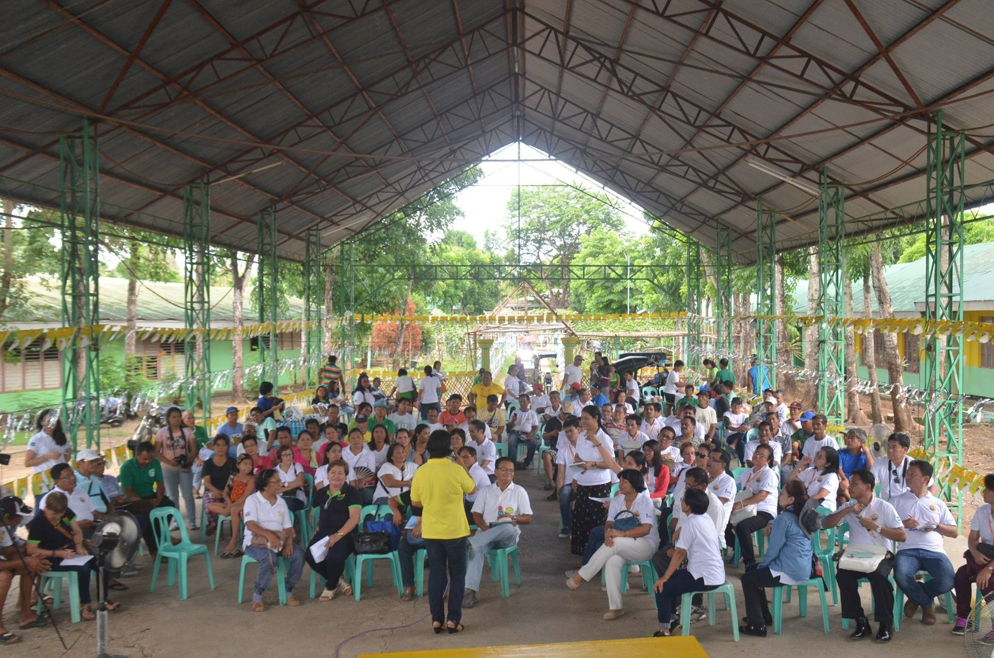 Participants and farmers on the mini-program before going on to the plots.