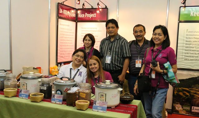 HRP team members ran the booth, which included displays of the Lab-labi, Ominio, and Unoy rice varieties for sample tasting.